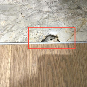 Large hole in marble floor tile