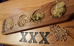 hops grains on paddle