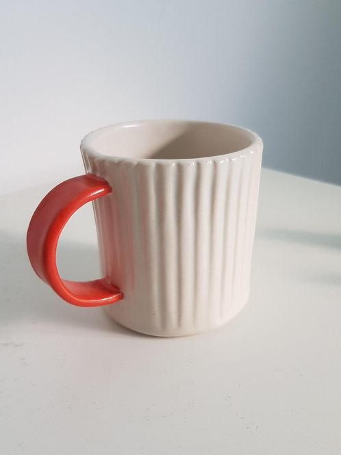 red handled mug