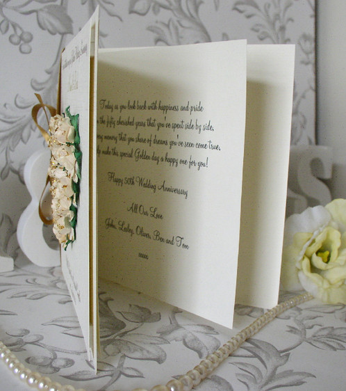 beautiful 300gsm opening ivory linen embossed card with a mounted panel featuring a stunning heart made up of ivory mulberry paper roses with gold glitter