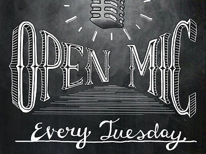 Chalkboard with Open Mic Night every Tuesday written in white