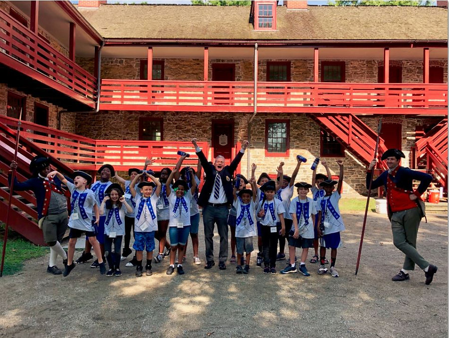 Students aged 9-12 attending Colonial Da