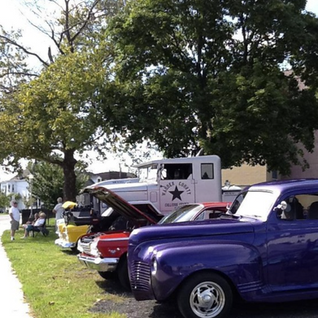 Row of old cars.png