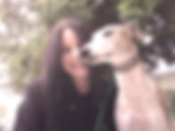 Pet sitter Kristin posing with Ludwig the Whippet.