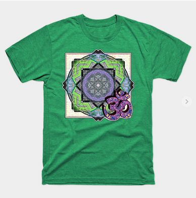 A green mandal pattern with om symbol on a tshirt, intricate geometric shapes against a white brick courtyard.
