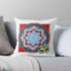 A pillow with a red mandala pattern and om symbol.