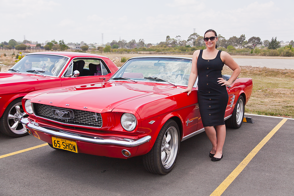 Kate Malgit standing next to her trophy winning Mustang