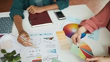 people-discussing-business-graphics-YFABKSM_edited.jpg