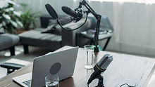 workspace-with-microphones-laptop-and-gl