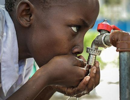boy-drinking-water-on-faucet-1446504.jpg