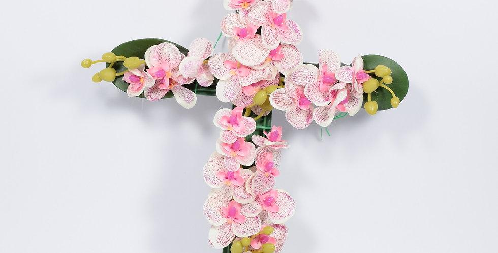 Στεφάνι με τεχνητές ορχιδέες σε σχήμα σταυρού. Σε ροζ χρώμα