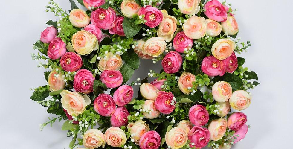 Στεφάνι με τεχνητά λουλούδιανεραγκούλες σε σομόν και ροζ, σε βάση από φελιζόλ.