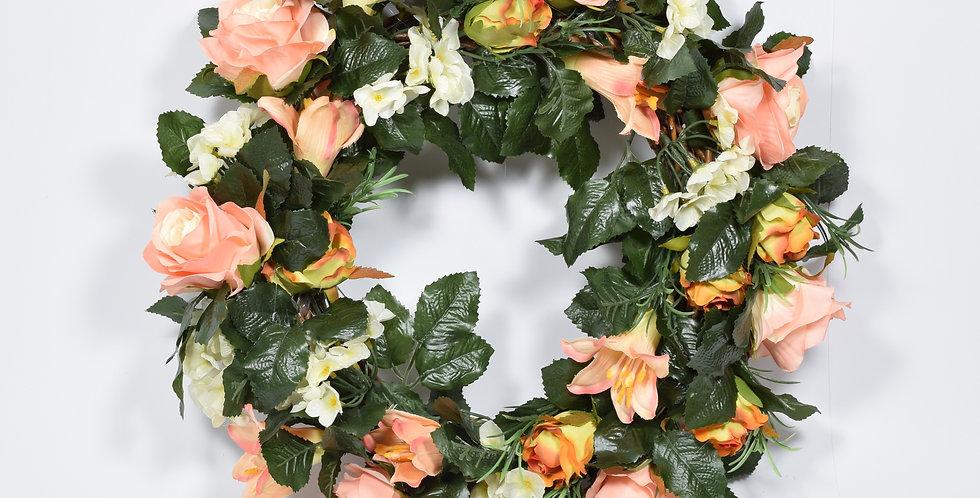 Χειροποίητο στεφάνι με τεχνητά τριαντάφυλλασε σομόν χρώμακαι λευκούς κρίνους, σε ξύλινη, πλεκτή βάση.