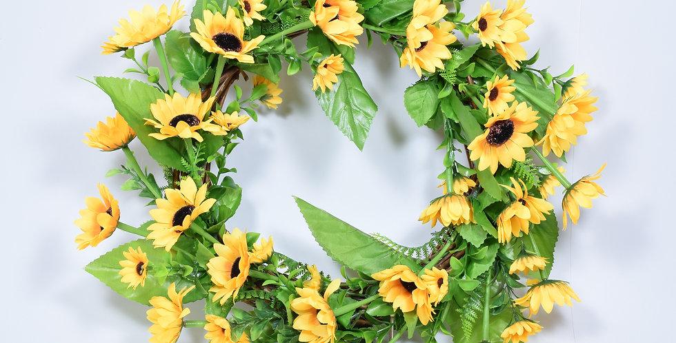 Χειροποίητο στεφάνι με τεχνητά λουλούδια, ηλίανθους, σε ξύλινη, πλεκτή βάση.