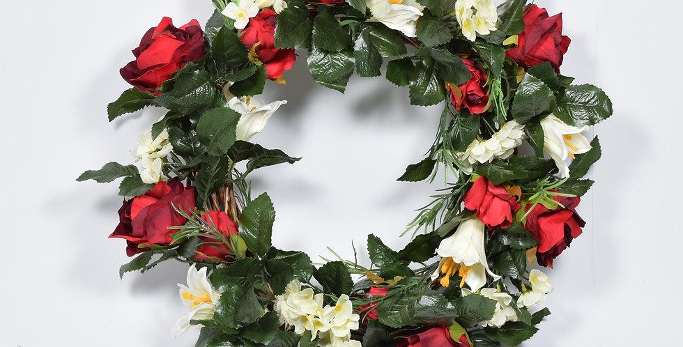 Χειροποίητο στεφάνι με τεχνητά τριαντάφυλλασε βαθύ κόκκινο χρώμα και λευκούς κρίνους, σε ξύλινη, πλεκτή βάση.