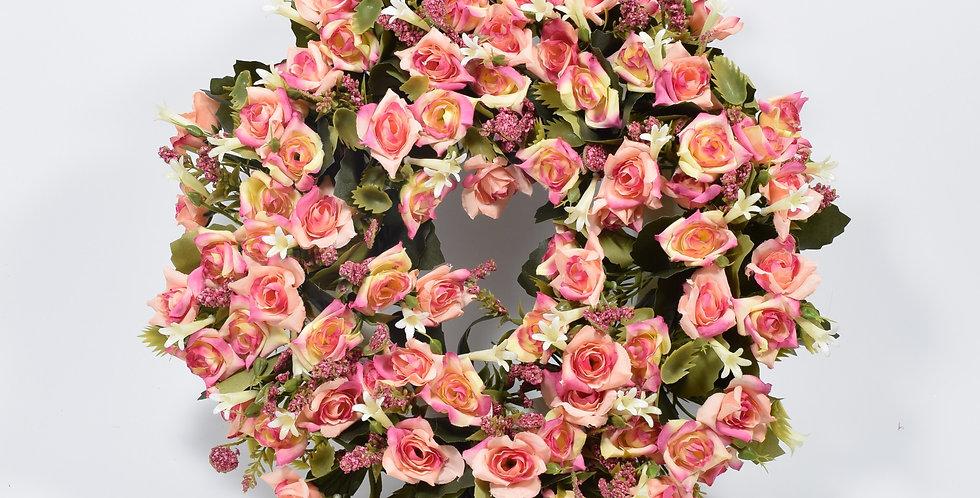 Στεφάνι με τεχνητά λουλούδιατριαντάφυλλα ροζ, σε βάση από φελιζόλ.