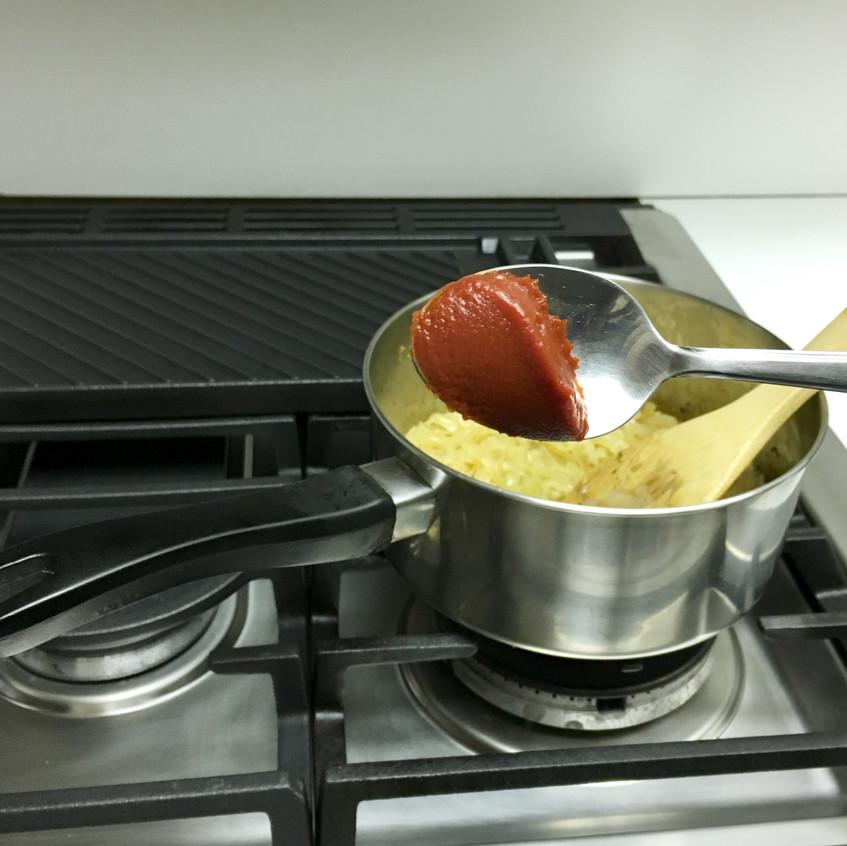 Add 1/2 tablespoon of tomato paste