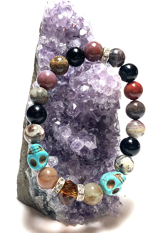 Healing agate with 2 turquoise skulls