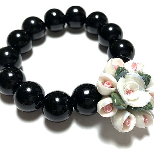 Chunky ceramic flower with black large beads