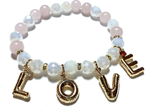 Gold toned LOVE charms with Rose Quartz