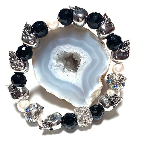 Gorgeous silver blue rhinestone and pearls with metal skulls