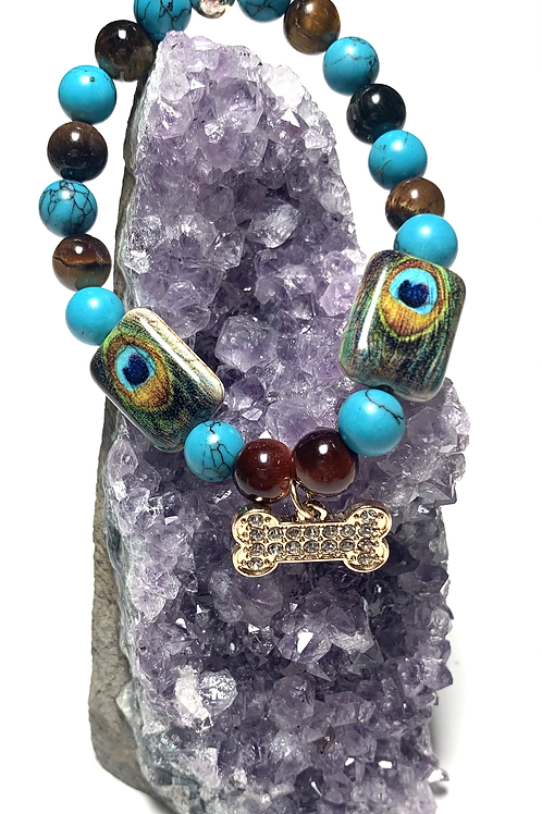 Peacock beads with gold toned rhinestone bone with turquoise and tigers eye
