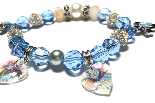 Two Silver toned crosses and crystal heart charms with glass blue beads