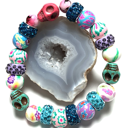 Colorful floral beads with 3 skulls with rhinestone connectors