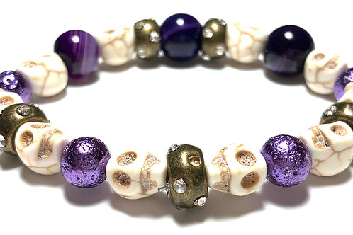 Chunky deep purple beads with natural skull beads and bronze toned connectors