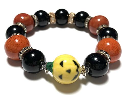 Chunky large ceramic burnt orange and black beads with yellow pumpkin
