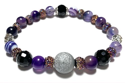 Stunning Druzy quartz stone with 2 metal skulls and purple and black beads