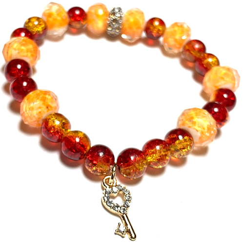 Gold toned crystal key with orange and amber mixed beads