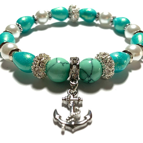 Glass pearls and mixed turquoise beads with rhinestone anchor Charm