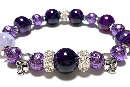 Chunky deep purple beads with 2 skull beads and rhinestones
