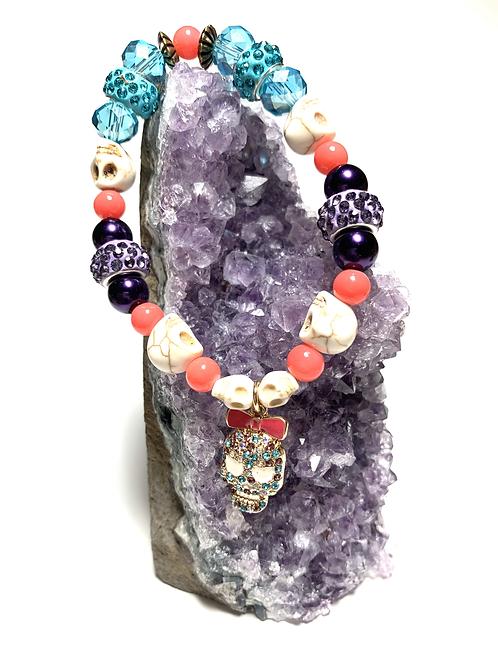 Rhinestone skull with natural skulls and mixed beads