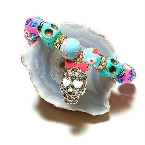 Vibrant Sugar Skulls with rhinestones and mixed beads