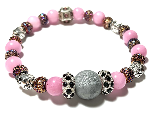 Stunning Druzy quartz stones with metal silver skulls and rhinestoned with pink
