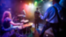band-performs-on-stage-in-a-nightclub-ZP