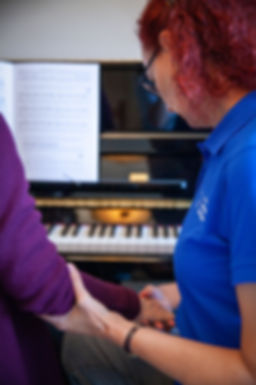 A piano player gets hands-on work in an Alexander Technique lesson for musicians