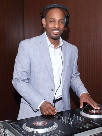 DJ Dyn-O-Might at a corporate event