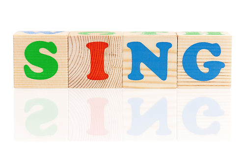 Sing word formed by colorful wooden alph