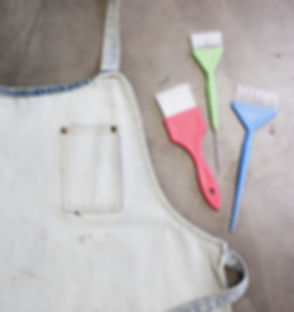 apron and brushes