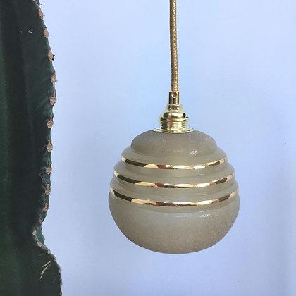 Baladeuse globe en verre granité