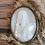 Thumbnail: Cadre bombé laiton et calcaire moulé