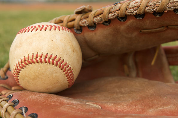 A picture of a baseball and glove - Link to registration