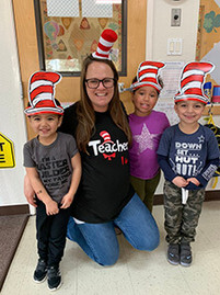 Teacher and daycare students wearing hats to celebrate Dr. Seuss day