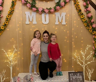 Mother taking photo with her children on Mother's Day