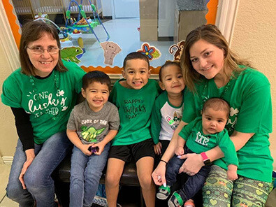 Teachers and children celebrating St. Patricks day