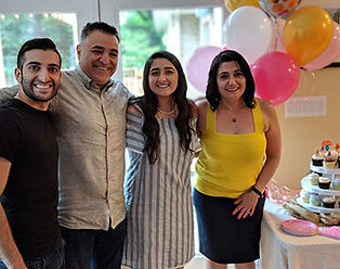 Preschool director taking photo with her family at her daughter's birthday party