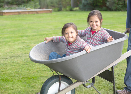 Twins with Down Syndrome in Wheelbarrow